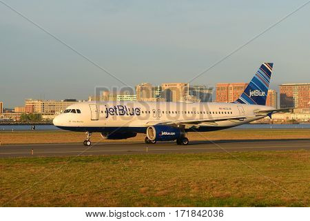 BOSTON - SEP. 25, 2015: Jetblue Airways Airbus 320 taxiing at Boston Logan International Airport, Boston, Massachusetts, USA.