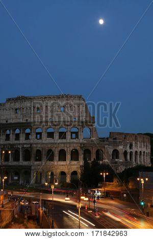 Night Coliseum moon cars lights rome italy