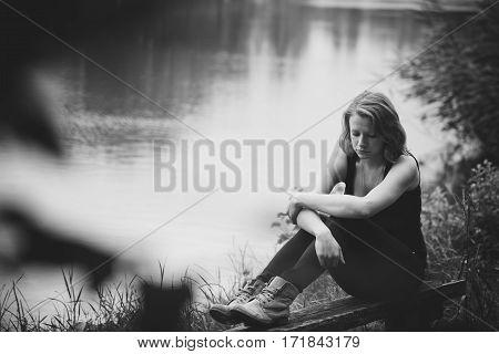 Woman feeling so alone at the lake