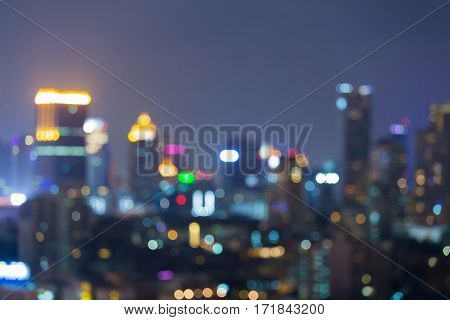 Night blurred bokeh office building light abstract background