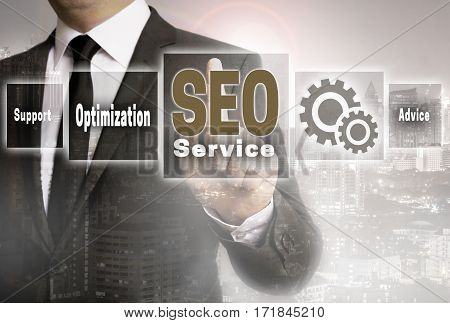 Seo Service Businessman With City Background Concept