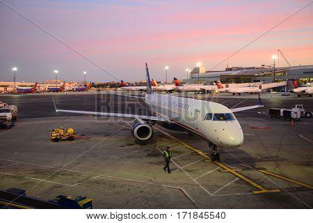 BOSTON - SEP. 26, 2015: US Airways Embraer 190 at Boston Logan International Airport, Boston, Massachusetts, USA.