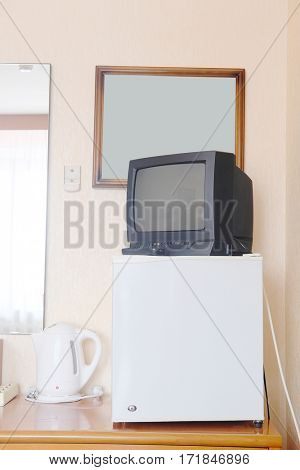 tv stands on a refrigerator