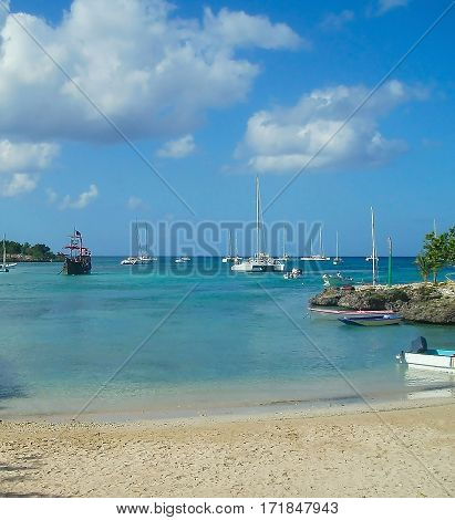 beautiful white sailboats and old pirate ship in the azure turquoise sea Caribbean Saona Dominican Republic