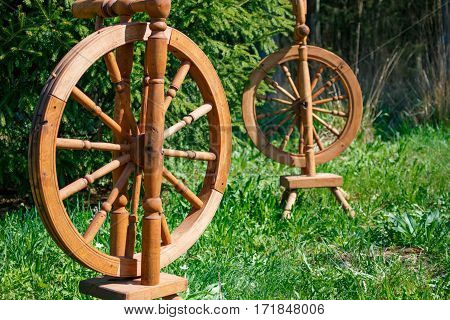 Old Wooden Spinning Swirling Amid The Green Park