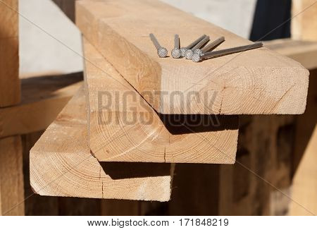 Boards with nails on a construction site