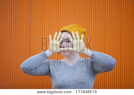 woman covered in orange dust isolated on orange background