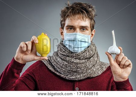 Ill man wears protective mask against infectious diseases and flu. Man knows that helping against common colds. Healthcare concept