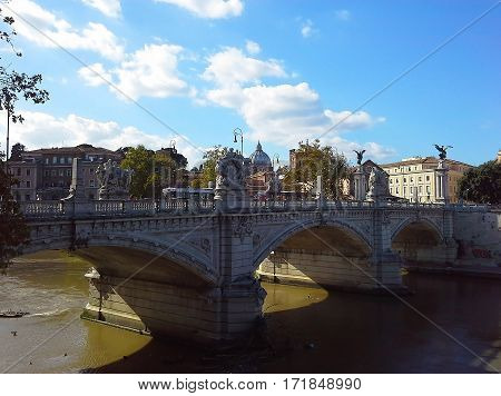 View of bridge of St Angelo Tiber River and St. Peter's Basilica Rome Italy