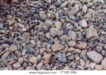 Sea stone and pebble background close up