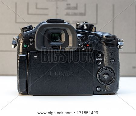 PARIS FRANCE - FEB 13 2017: Rear view detail of the Panasonic Lumix DMC-GH4 - Micro Four Thirds System digital still and video camera originally released in May 2014. At the time of its release the GH4 was notable for being the world's first Mirrorless in