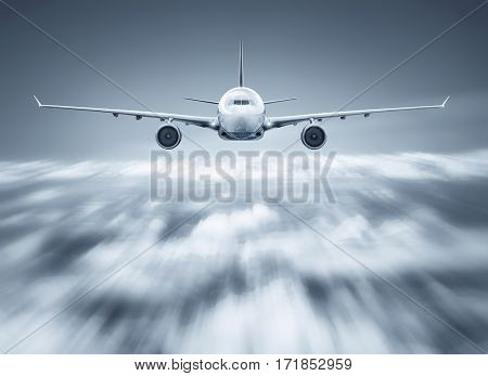 airliner flying over the clouds with high speed