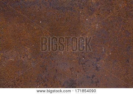 Dark worn rusty and cracked metal texture background.