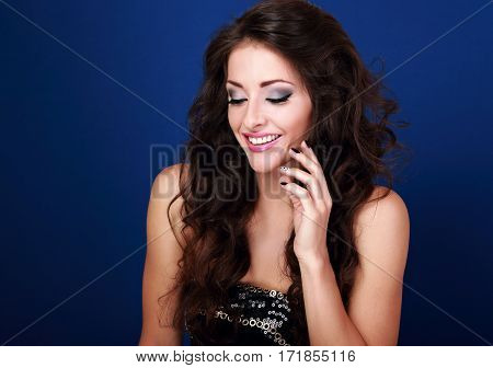 Beautiful Laughing Makeup Woman With Long Volume Hair And Manicured Nails On Bright Blue Background