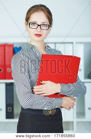 Portrait of confident business woman looking at camera with document case in hands. Modern communication technology, business presentation, woman in suit use smartphone searching information concept.