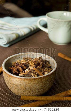 An earthy bowl filled with mulling spices.