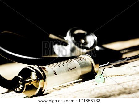Antique Medical Tools On A Wood Background