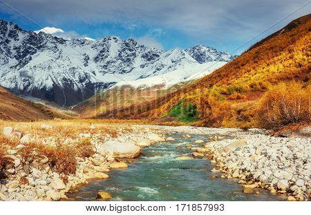 Snowy mountains and noisy mountain river. Georgia, Svaneti Europe