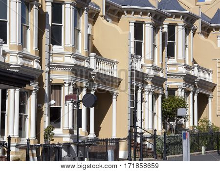Attached twin houses on Stuart Street in Dunedin old town (New Zealand).