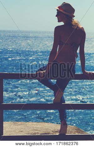 Silhouette of a young girl enjoying with sea / ocean background.