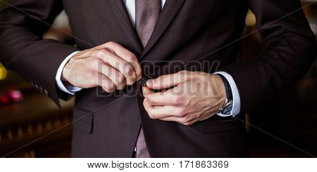 correct button on jacket hands close-up dressing