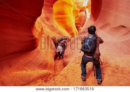 Tourist taking photo in Lower Antelope Canyon in the Navajo Reservation near Page Arizona USA
