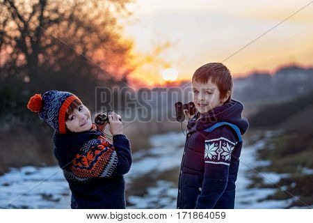 Two Little Children, Boys, Exploring Nature With Binoculars