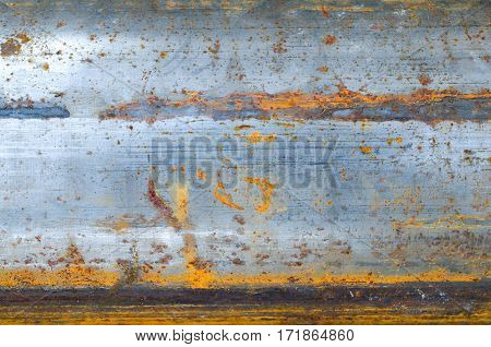 Bulk metal tube with rust. Texture background