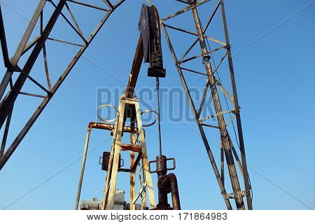 oil and gas industry. Crude oil mining pump under blue sky