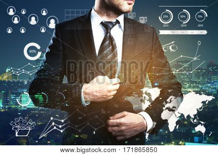Businessperson on night city background with business charts and graphs. Double exposure. Employment concept