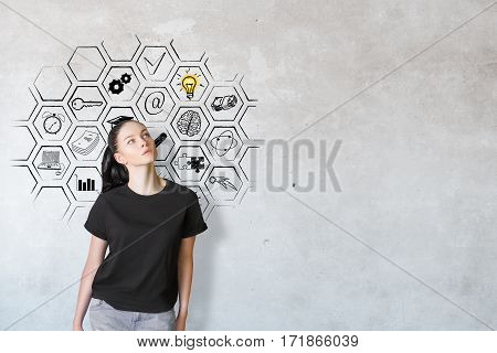 Thoughtful caucasian female on concrete background with drawn business icons inside abstract cell mesh. Success concept