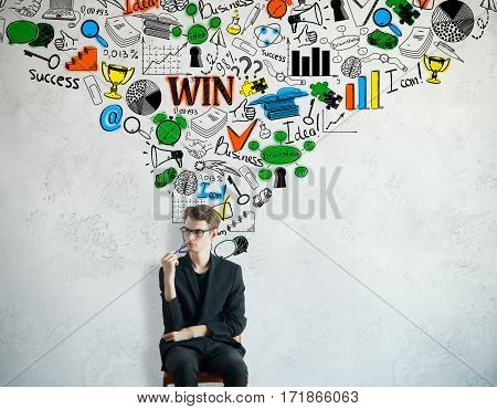 Thoughtful young man on concrete background with colorful business sketch. Leadership concept