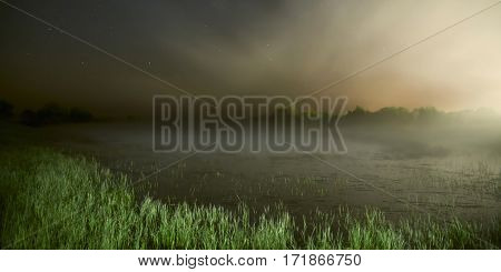 starry sky night photography astrophotography fog over the lake the grass lit by flashlight