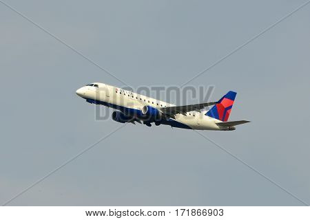 BOSTON - MAY. 6, 2015: Delta Airlines Embraer 175 take off at Boston Logan International Airport, Boston, Massachusetts, USA.