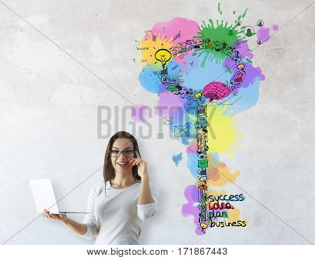 Busy caucasian girl on concrete background with creative business keys sketch