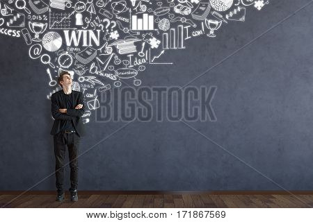 Young caucasian man looking up at business sketch drawn on concrete room wall. Leadership concept. 3D Rendering