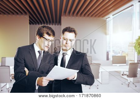 Handsome caucasian businessmen discussing contract in modern office. Partnership concept. 3D Rendering
