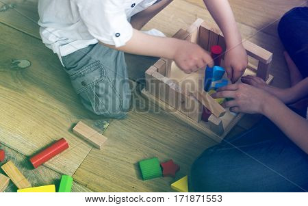 Photo Gradient Style with Little Children Playing Toy Blocks