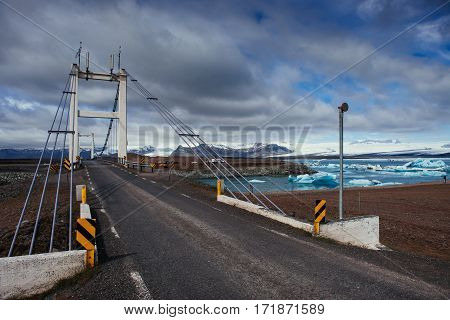 Bridge over a channel connecting Jokulsarlon Lagoon and Atlantic Ocean in southern Iceland