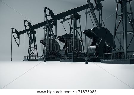Side view of dark oil derricks on light background. Petrol concept. 3D Rendering