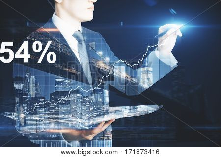 Side view of european businessman with open notepad writing something on abstract city background with business chart. Finance concept. Double exposure