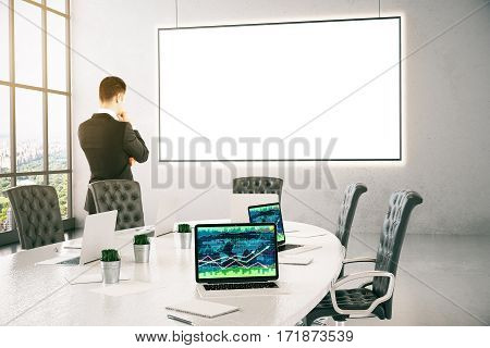 Thoughtful businessman in modern conference room with city view forex chart and blank whiteboard. Mock up 3D Rendering
