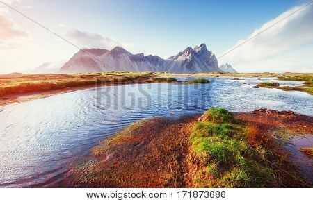 Gentle slopes snowy mountains and glaciers. Gorgeous autumn Iceland.