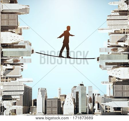 Businessman silhouette balancing on rope. Abstract cityscape background