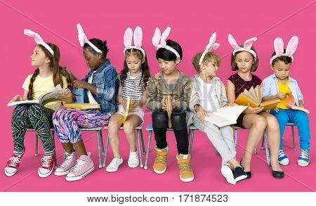 A bunny team reading a book
