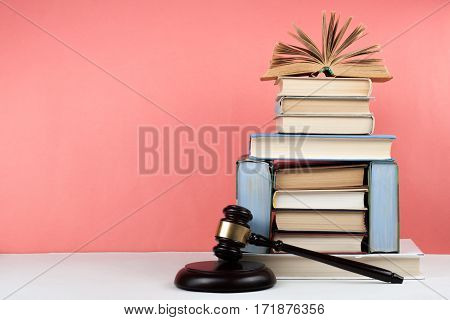 Open book hardback colorful books on wooden table. Back to school. Copy space for text. Education business concept