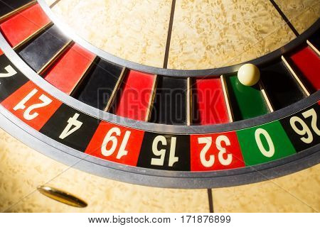 ball in winning number zero at roulette wheel