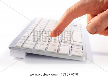 Typing on keyboard. Isolated over white background.