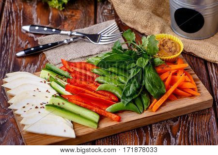 Sliced Veggies (celery, Carrots, Peppers, Cucumbers) Are On The Board.