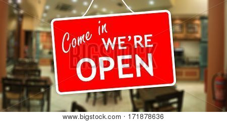 We Are Open Sign On Glass Storefront